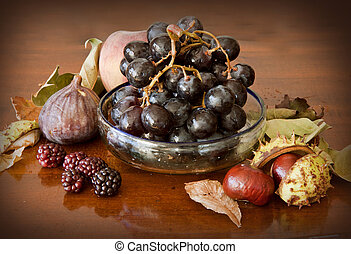 Autumnal fruits on a wooden table