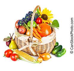autumnal harvest vegetables and fruits in basket