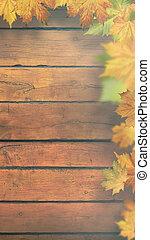 Autumnal leaves over old wooden desk, seasonal banner