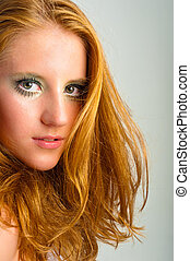 autumnal makeup on a young model against isolated white background