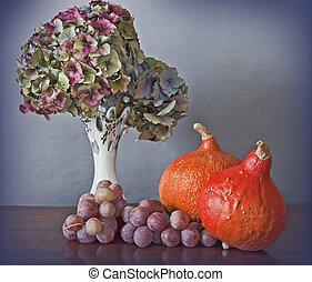 Autumnal still life: pumkins,grapes and Hydrangea flowers