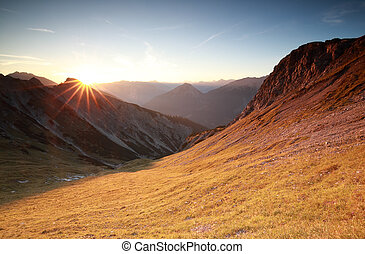 autunm sunrise over mountains in Alps