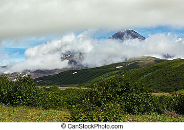Avacha Volcano or Avachinskaya Sopka in the clouds on Kamchatka Peninsula
