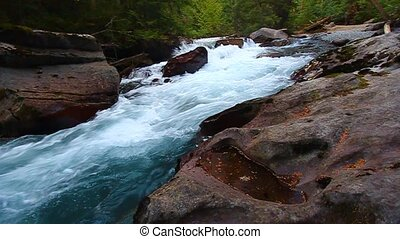 Avalanche Creek - Montana - Cascading water from snowmelt in...