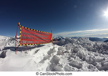 avalanche danger sign in snow