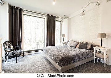 Avant-garde, bright bedroom with king-size bed, big window ...