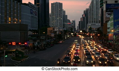 Avenue evening Time Lapse. Heavy traffic jam flowing with blurred motion lights