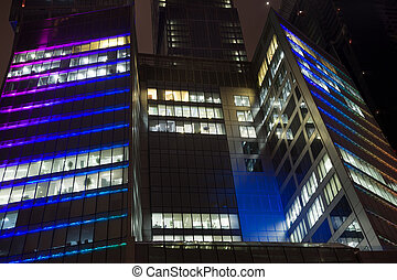 average floors of modern office building at night, skyscraper in moscow, foreshortening from below
