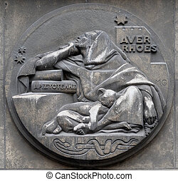 Averroes, was a medieval Andalusian polymath. He wrote on logic, philosophy, medieval sciences of medicine, astronomy, physics. Stone relief at the building of the Faculte de Medicine Paris.
