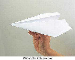 avión papel, en, mujer, mano