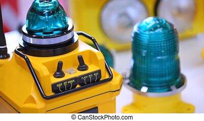 Aviation radio beacon of yellow color blinks dark blue light