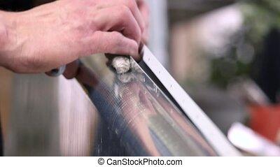 Aviation sheet metal fasteners. Hands of male worker.