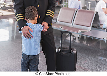 Aviator embracing his small son - After long parting. Little...