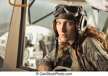 Aviator female - Portrait of young woman pilot in a military...