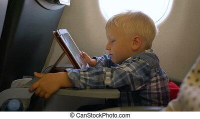 avion, garçon, voyager, peu, jouer, informatique, tablette
