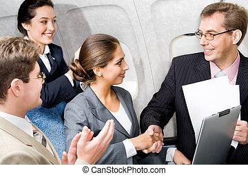 avion, poignée main