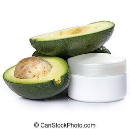 Avocado and moisturizer cream - Fresh avocado and jar of ...