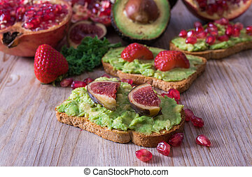 avocado and red fruit toasts from the vegan or vegetarian diet