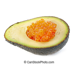 avocado and salmon eggs in front of white background