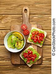 Avocado and tomatoes healthy toasts