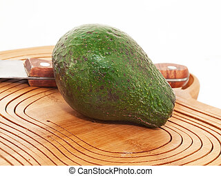 Avocado at the cutting board