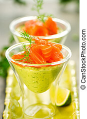 avocado cream and salmon in glasses