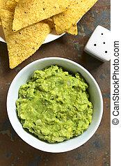 Avocado Dip - Avocado dip or guacamole in bowl with corn...