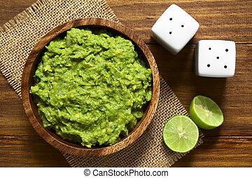 Avocado Dip - Avocado dip or guacamole in wooden bowl,...