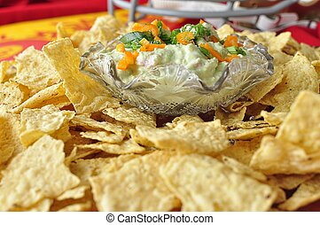 Avocado Dip /Chips - Avocado dip with chips on platter.