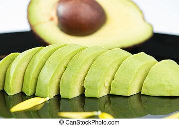 Avocado fruit on black floor