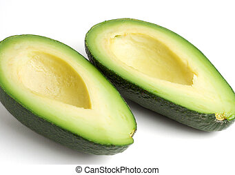 Avocado halves - Side view of two avocado halves, isolated ...