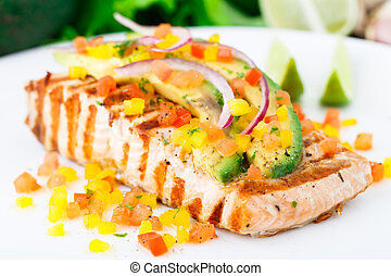 Avocado lime salmon with diced vegetables on a plate