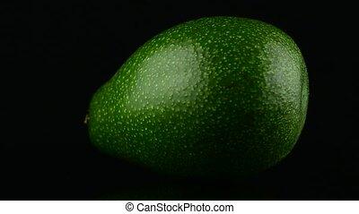 Avocado on black  - Avocado fruits on black background.