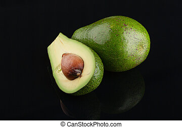 Avocado on black background . Symbol or Fresh Organic Fruit or vagitable for Healthy Lifestyle Concept