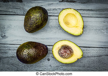 Avocado on wooden, old background