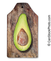 Avocado on wooden table.