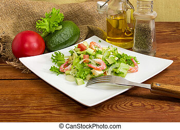 Avocado salad with vegetables and some ingredients for its preparation