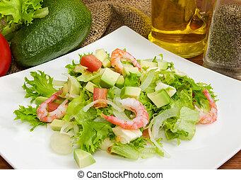 Avocado salad with vegetables, mozzarella, shrimps, closeup among some ingredient