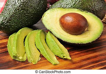 Avocado slices - Sliced avocado on a cutting board