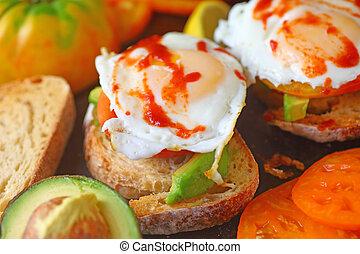Avocado toast, eggs and chili sauce