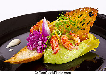 Avocado tureen with seafood and tomato paste