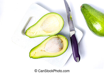 Avocados on a cutting board top view