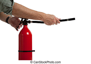 A man's hands and arms acitivating a fire extinguisher - avoiding an emergency