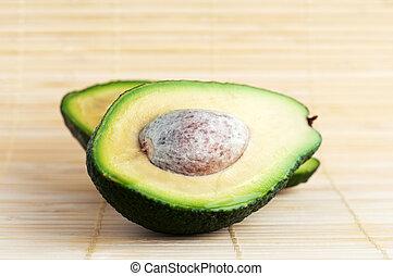 avokado - two halves of avocado