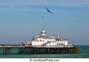 Avro Lancaster and Spitfire MK1 flying over Eastbourne Pier
