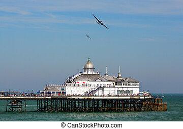 Avro Lancaster and Spitfire MK1 flying over Eastbourne Pier