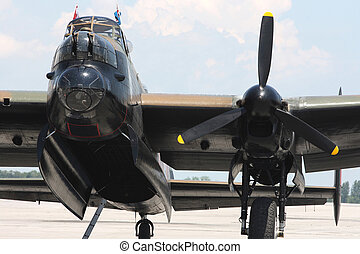 Front view of the Lancaster Bomber - cockpit, open bomb bay, One of four engine Rolls Royce Merlin, Nose outamatic weapons,