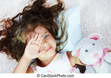 Awake - Portrait of lovely girl with teddybear rubbing her...