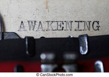 Awakening as typed in an old vintage paper macro shot.
