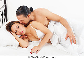 awaking couple in bed